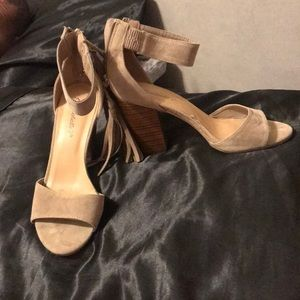 Great heels with a fringe zipper. Size 8